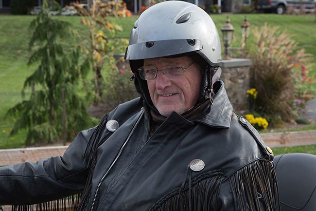 Photo of a man on a motorcycle
